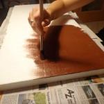Lackieren der Rückwand mit Abtönfarbe